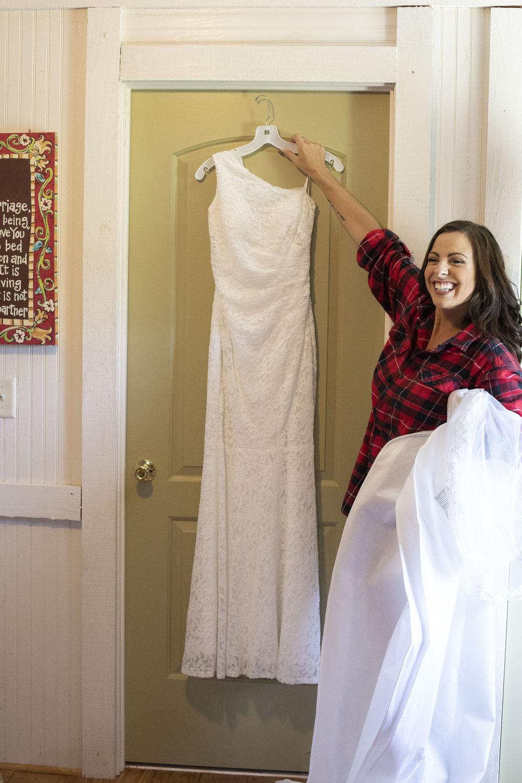 Bride-revealing-wedding-dress-candid-bridesmaids.jpg