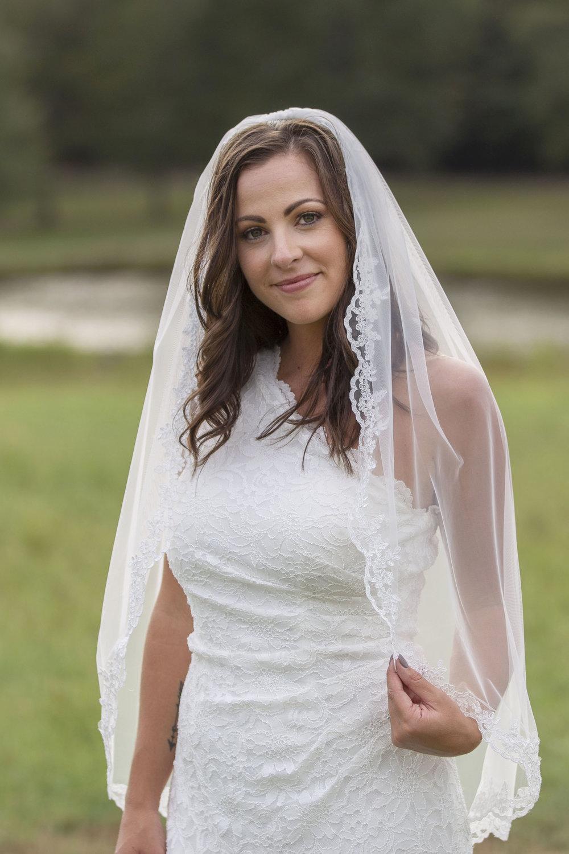 Bride-touching-veil-photography.jpg