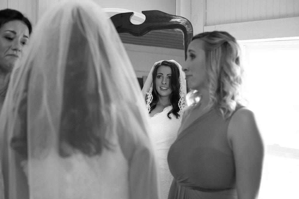 getting-ready-bride-mirror-dress-veil.jpg