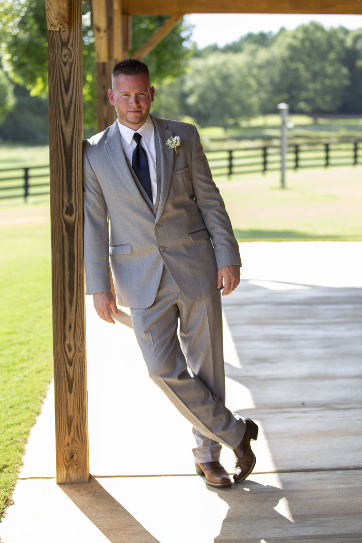 groom-grey-suit-navy-tie-serious.jpg