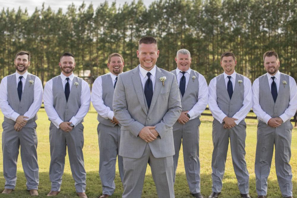 groom-posing-groomsmen-grey-navy.jpg