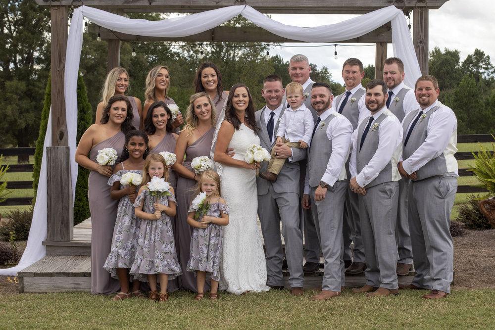 bridal-party-posed-at-alter.jpg