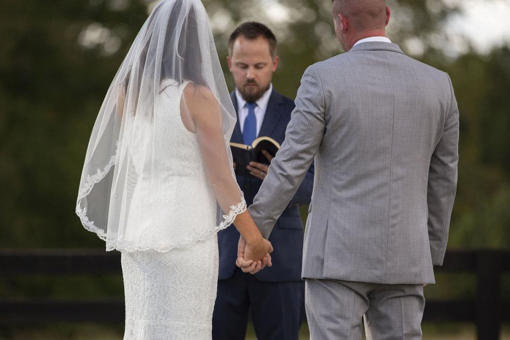 bride-groom-holding-hands-alter-ceremony.jpg