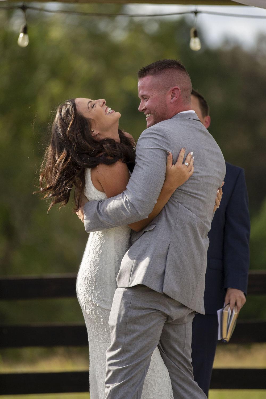 newlyweds-kissing-alter-bride-groom.jpg