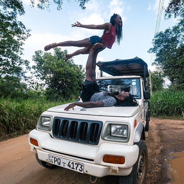 At the safari in Sri Lanka just doing what wild animals do! 😂🤸🏾♀️🤸🏾♂️. These two road runners are hitting the road again this time taking Yoga Day to LONDON!!! . @dade2shelby are hosting 3 classes/workshops at the beautiful @oneyogalondon. Grab a yoga ॐmie or 3, and join us!  Expect: Lots of yoga. Lots of laughs. Lots of community ☺️. . 2PM- Hips and Heart Soul Flow (Tie). 4PM- Rooted in Power (DJ). 6PM- AcroYoga Workshop (Both). . Link in Bio for tix! Tag someone you think would LOVE to practice with us below! 👇🏾 . #AASBYogaDay #YogaDayTour #LondonYoga #LondonYogis #YogaWorkshop #YogaClass #HippieHeathen #RastaYoga