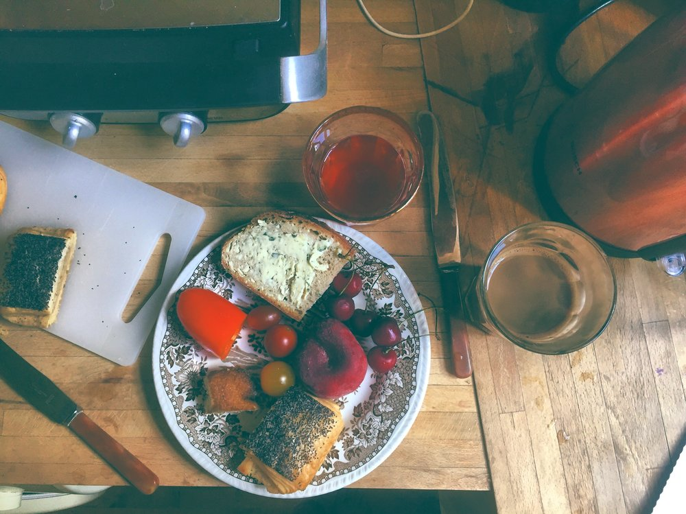 A very Danish breakfast: Home brewed rhubarb Kombucha, coffee, fresh bread with herb butter, peaches, cherries, sweet peppers, heirloom tomatoes, and danish pastries.