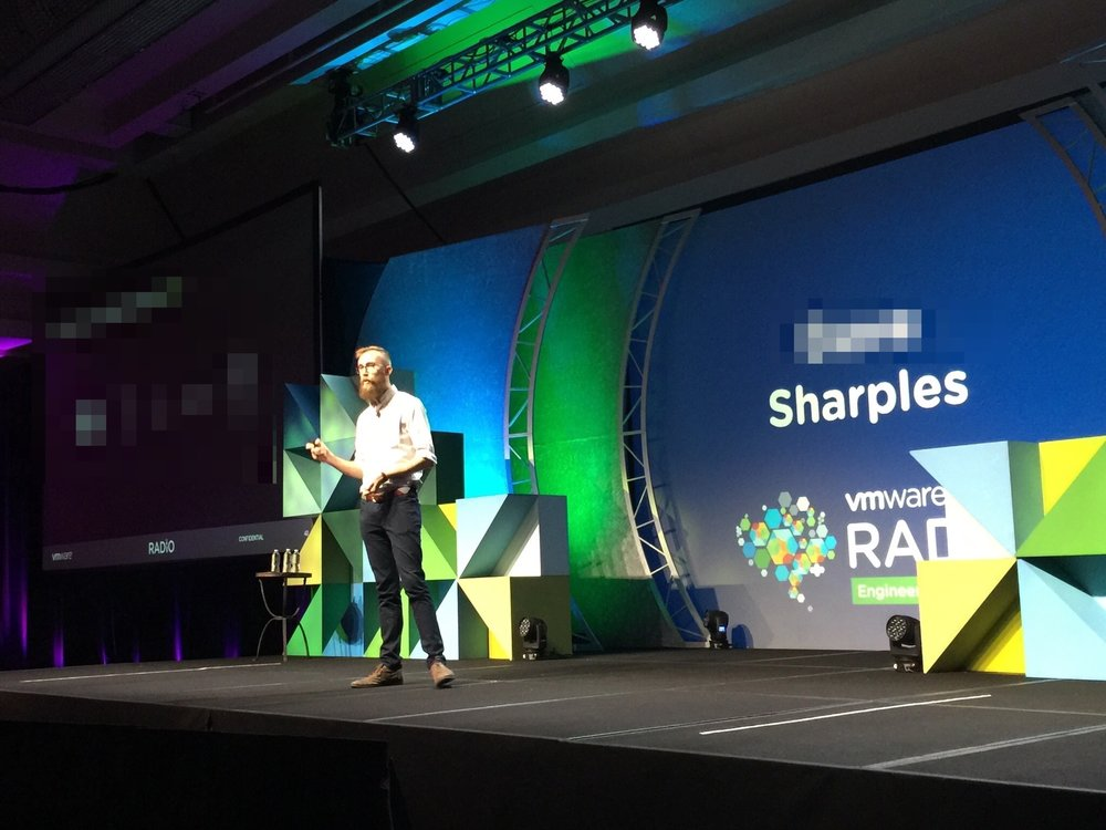 A (pre-transition) photo of me giving a talk about my research project at VMware's R&D conference!