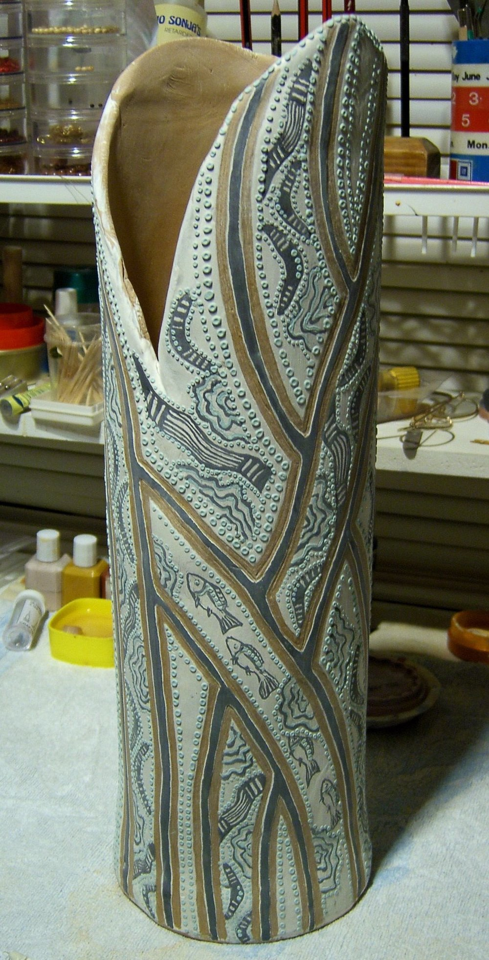 Tall vase with fish pattern