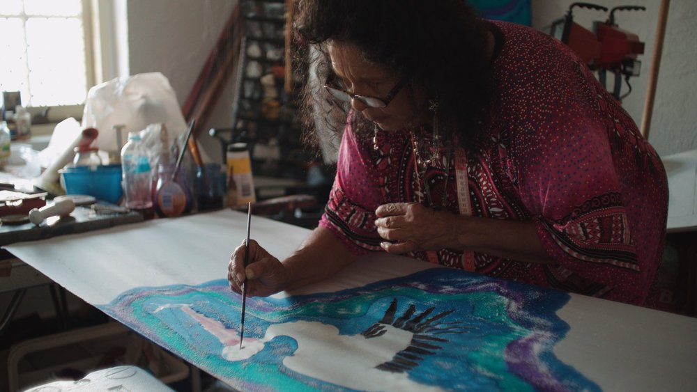 Betty Sumner painting on silk in Raukkan. Photo Change Media, March 2017