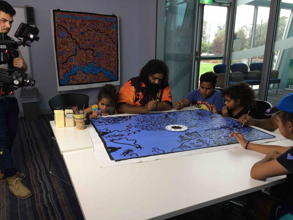 Cedric and his family painting at the Pt Pirie Arts Centre. Photo Carl Kuddell, April 2017