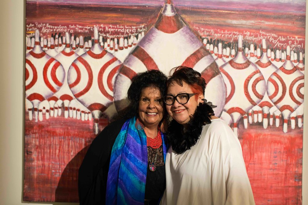 Betty Sumner and a friend in front of her work, The Protectors. Photo Johanis Lyons-Reid / Change Media