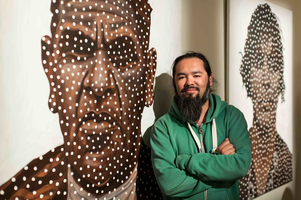 Damien Shen in front of his work, Greatgrandparents. Photo Johanis Lyons-Reid / Change Media