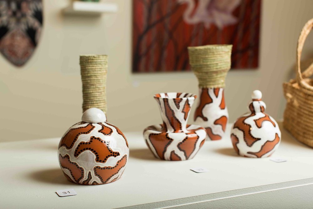 Glazed vessels with traditional weaving