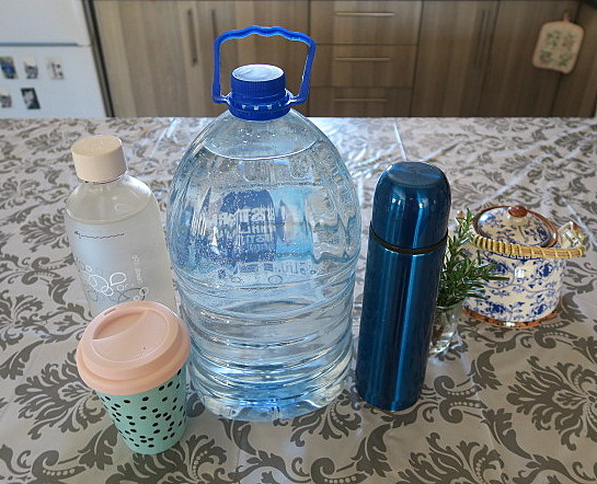 Restaurant survival kit. (I leave the herbs and teapot behind.) The bottle of non-potable water is for use in the restaurant toilet.