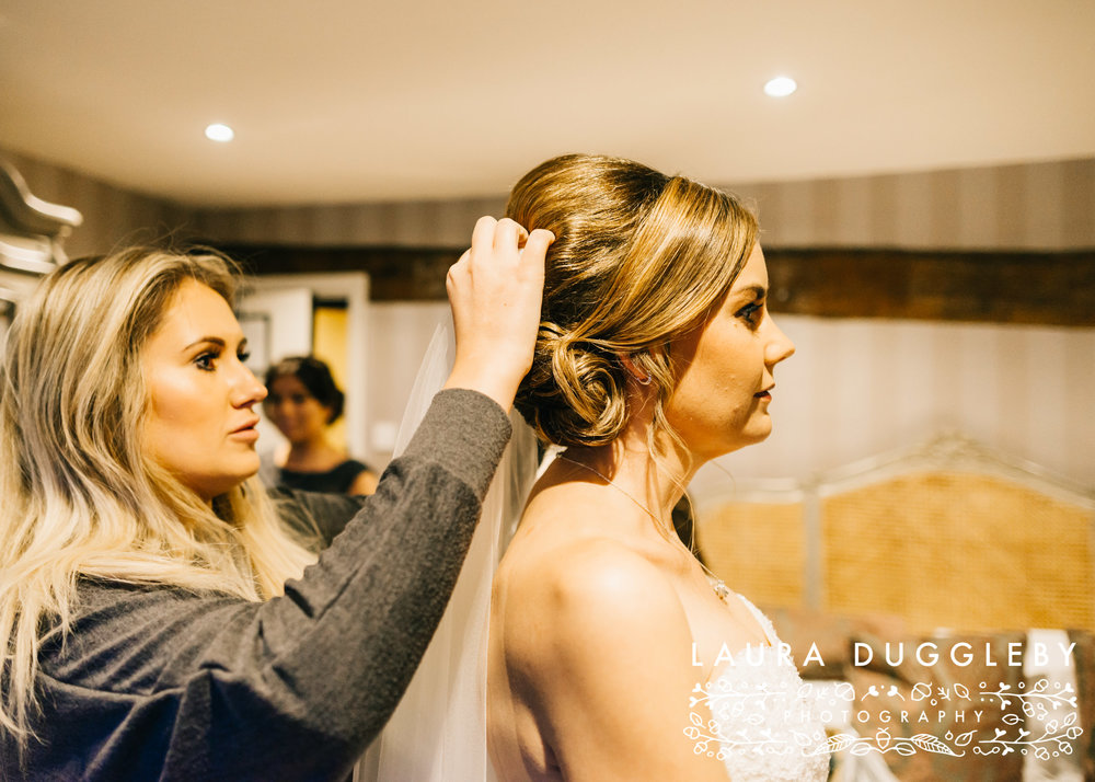 Ribble Valley Wedding Bride Having Veil Put In Hair Shireburn Arms