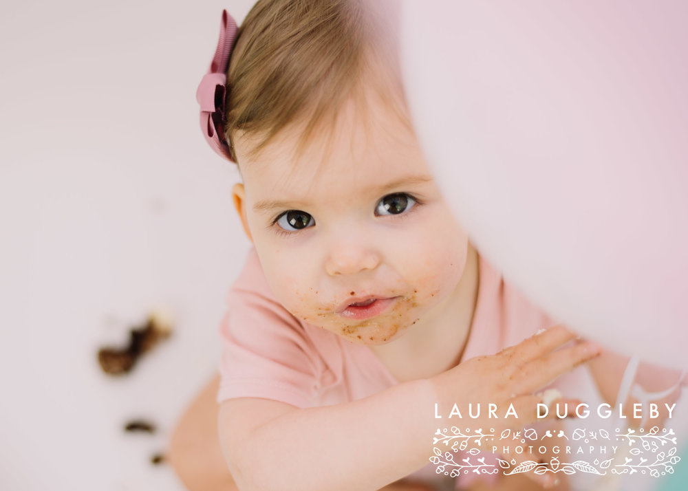 baby girl cake smash session with balloons
