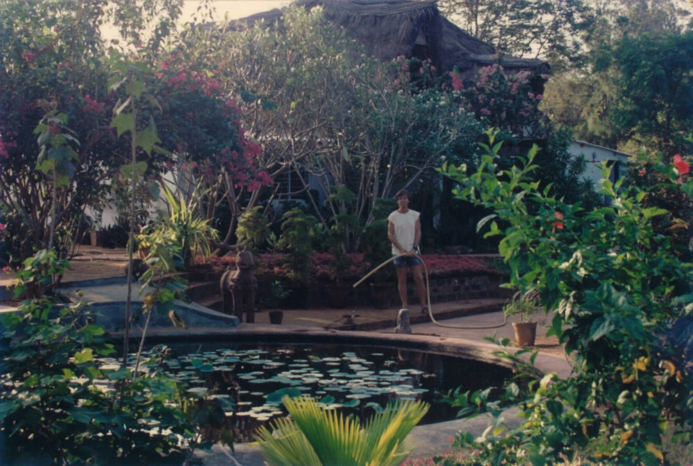 IGOR WATERING HIS GARDEN IN HIS ARSPIRATION HOUSE IN AUROVILLE INDIA - b .jpg