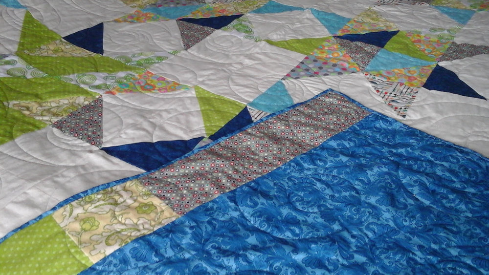 "Perfectly Wonderful - ""My project turned out perfectly wonderful. I would highly recommend leaving your quilts with Rose. You'll be happy you did.""           Kathy Richards"