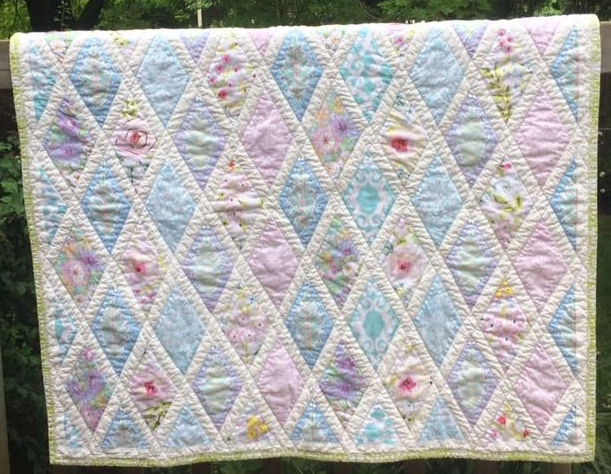 An English Garden - I asked Rose to create a quilt to celebrate the birth of our granddaughter. My only suggestion was to remind one of