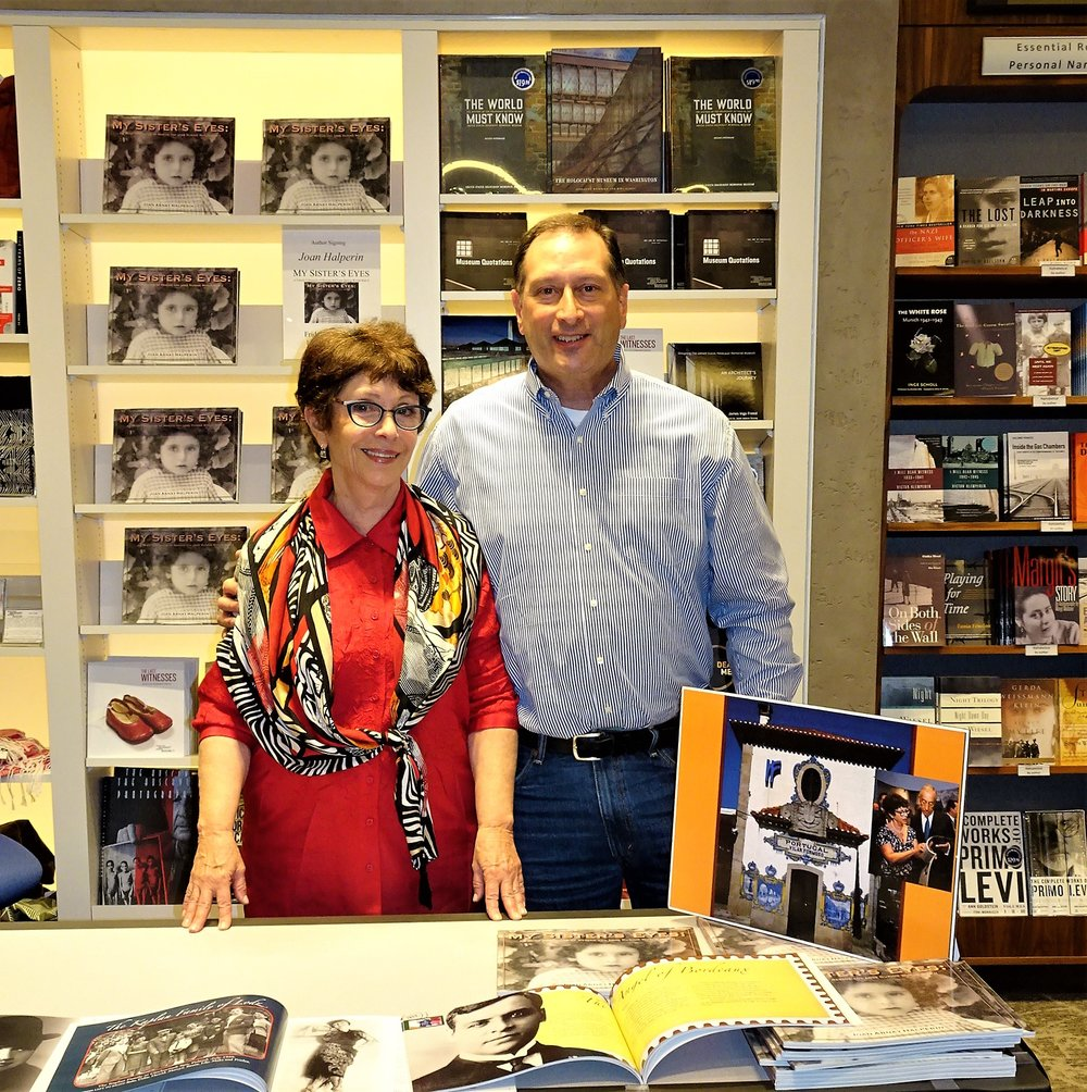 This is a family affair. Richard Arnay, brother and enthusiastic supporter, joins Joan at the USHMM Museum Shop and buys copies of  My Sister's Eyes  to share with his friends. And, special thanks to Itzhak Halperin, Joan's partner of 44 1/2 years, the eye behind the lens.