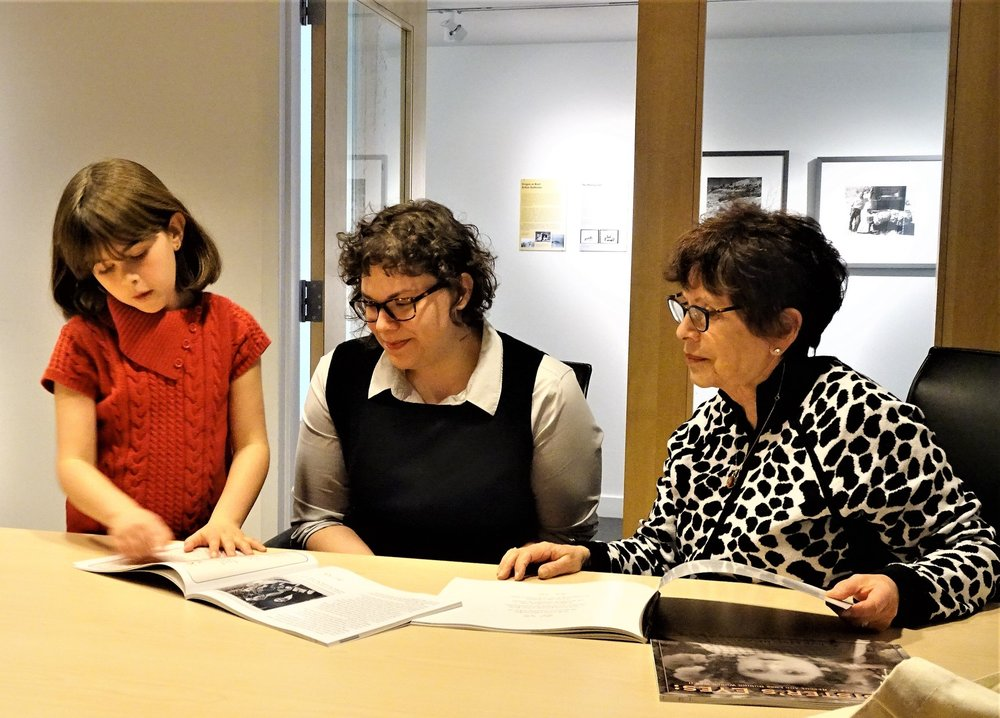 Here she is presenting copies of    My Sister's Eyes    to  April Slabosheski  (center), Director of Education at OJMCHE. Her grandmother and author of the book,  Joan Arnay Halperin,  looks on with pride.  OJMCHE makes  Holocaust Educational Trunks  available to middle and high school teachers for use in their classrooms to study  Holocaust Rescuers  among other subjects.