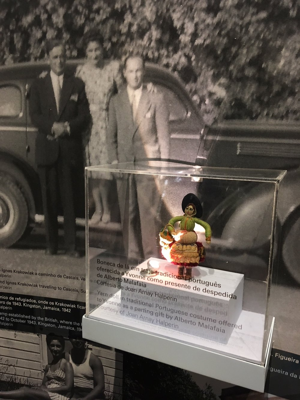 Yvonne Krakowiak's Minho yarn doll on display at the Fronteira da Paz Museum in Vilar Formoso, Portugal.  Picture above: Alberto Malafaia, Hala and Ignas Krakowiak with the automobile the Krakowiaks drove to safety (c. 1940-41). Pictured below: Hala and Ignas seated in front of their barrack at Gibraltar Camp, Kingston, Jamaica, where the couple found refuge after they were evacuated from Portugal on January 24, 1942.