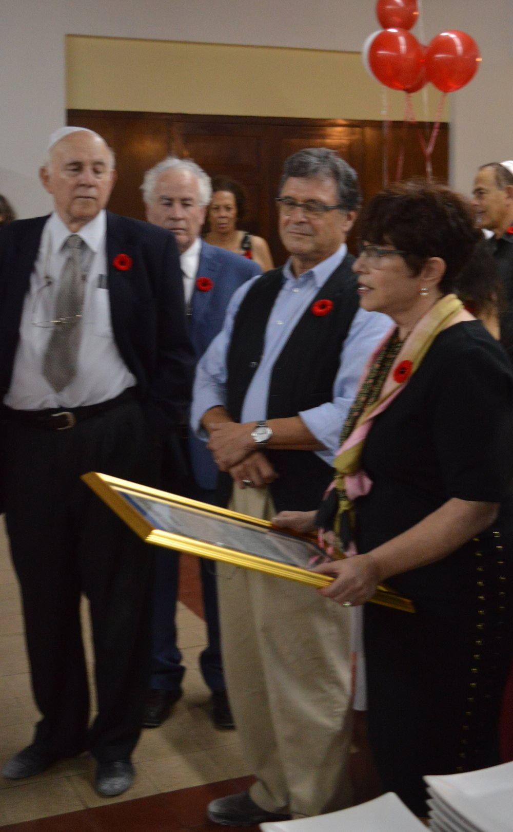 Joan presents a plaque from the Sousa Mendes Foundation (SMF) to the Israelite Community of Jamaica in recognition of the role members of the community played in making life better for the Jewish residents of Gibraltar Evacuee Camp from 1942 - 1946, when the last evacuees left Jamaica.  L to R: Ainsley Henriques, Itzhak Halperin, Joan and Robert Jacobvitz, Chair of the SMF Advisory Council.