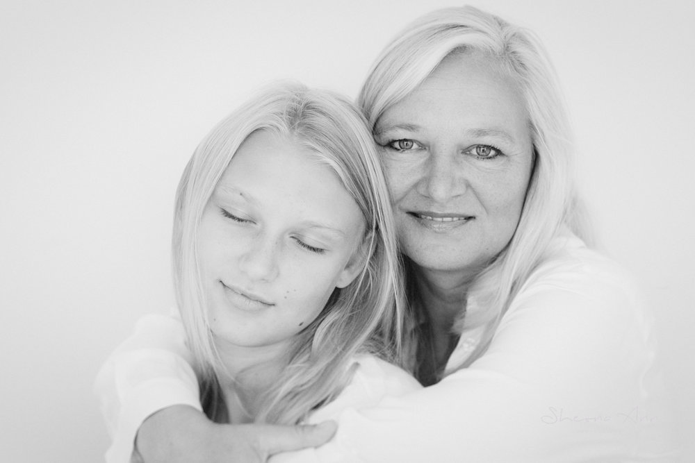 black-white-portrait-of-mother-holding- teenage-daughter (3 of 20).jpg