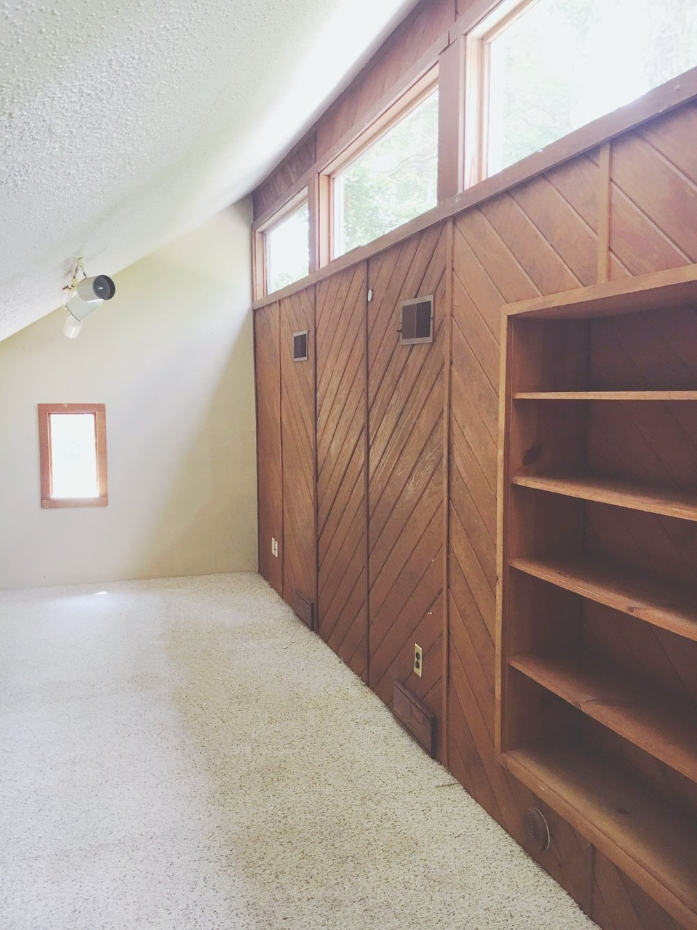 the loft: please shield your eyes from the hideous carpet + popcorn ceiling and instead love the clerestory windows, sexy cedar planked wall, built-in storage, and the fact that it's a loft at all!