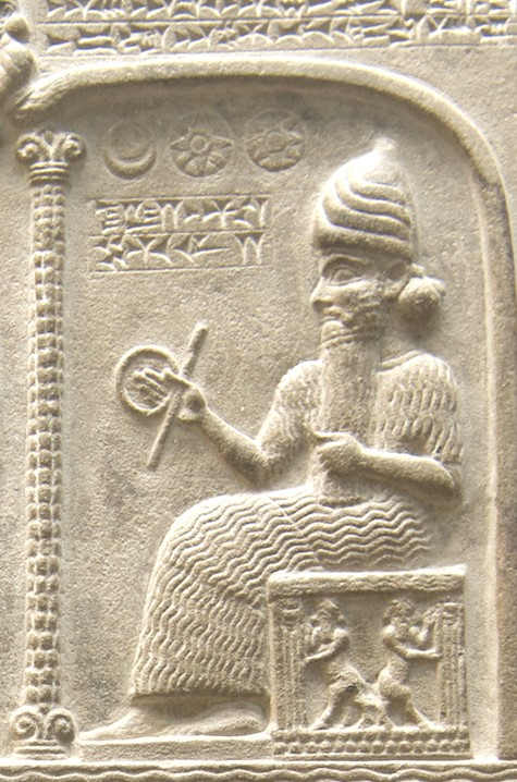 Mesopotamian god Shamash holding the cord and rule