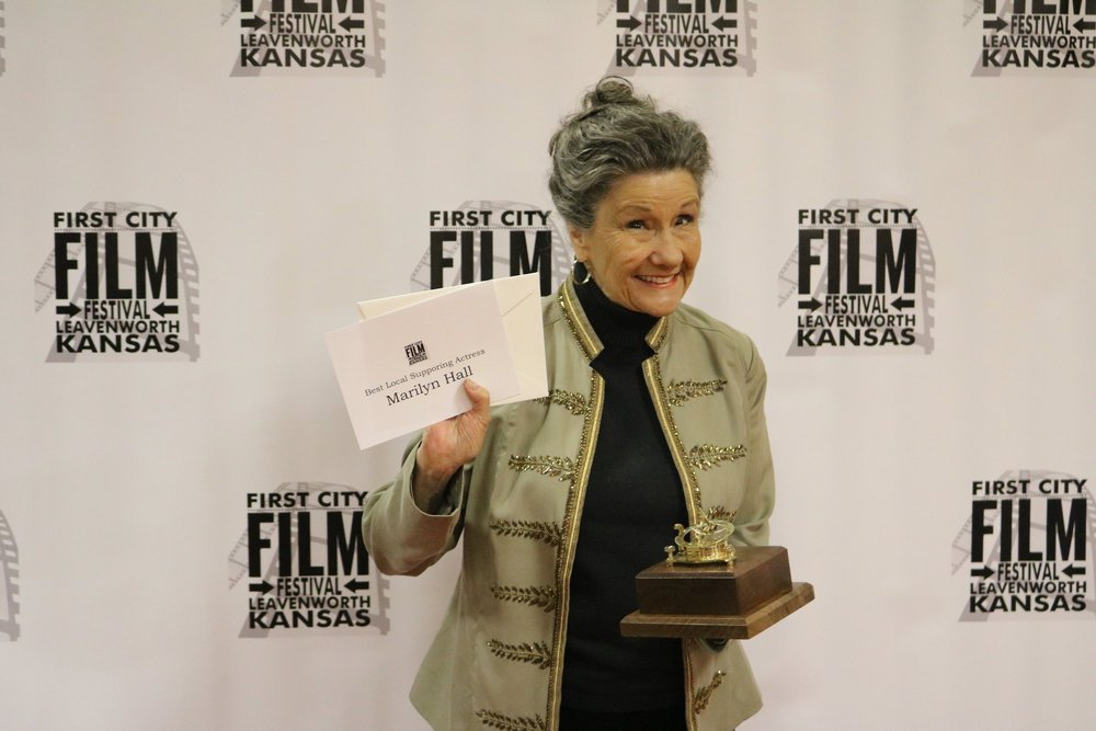 Best Local Supporting Actress, Marilyn Hall, holds her award during the First City Film Festival VIP Soiree March 23 at the Riverfront Community Center in Leavenworth KS. Photo by Lucas Guevara.