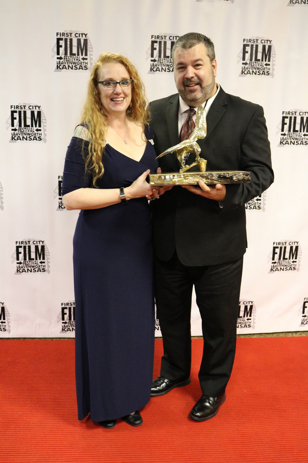 First City Film Festival Director Tisha Swart-Entwistle poses with the 2018 Andy Entwistle Spirit Award Recipient Eric Willis during the awards ceremony March 23, 2018 at the Riverfront Community Center in Leavenworth, Kan.