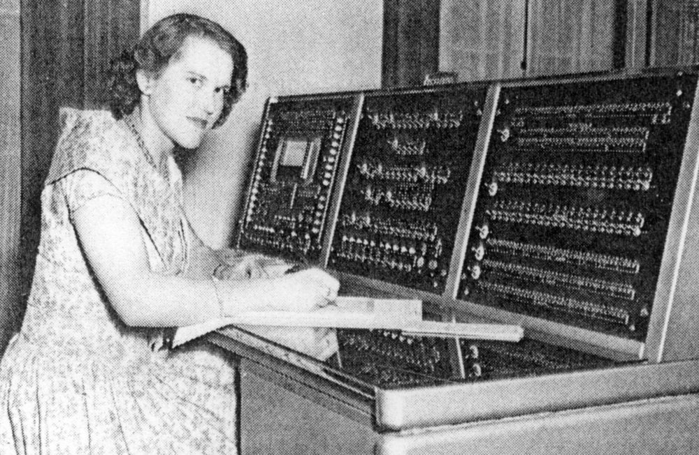 A programmer, Andrina Wood, at the console of a British Tabulating Machine Co., or BTM, computer in 1958. PHOTO: MIT PRESS