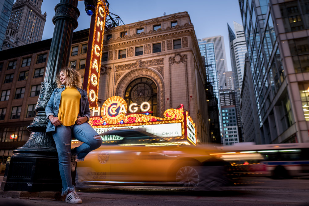 Renee in Chicago standing next to Chicago Theater