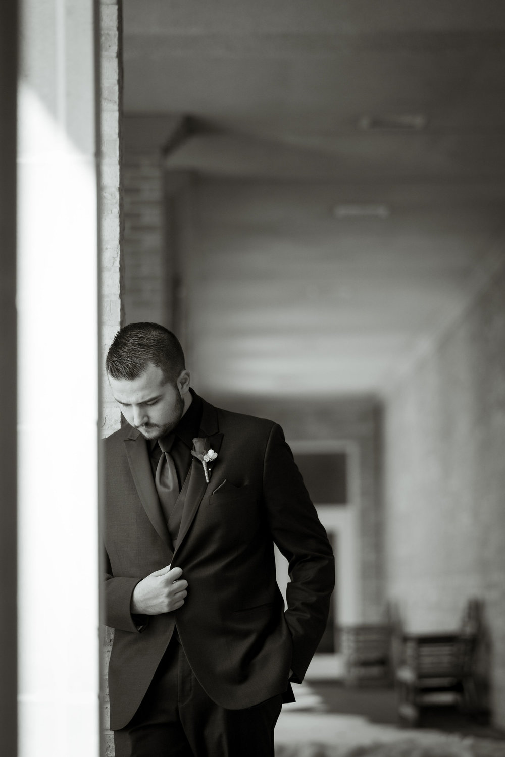Artistic shot of groom before the wedding at Sand Creek Country Club in Chesterton Indiana.