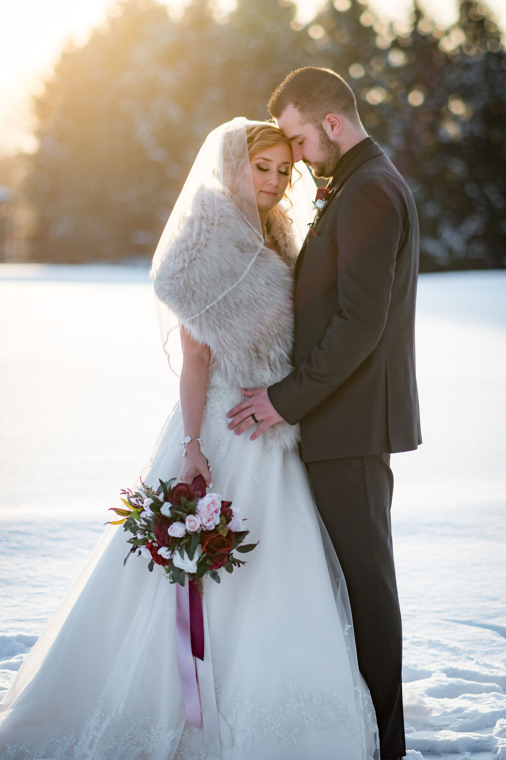 Sunset bridal portraits in January at Sand Creek Country Club.