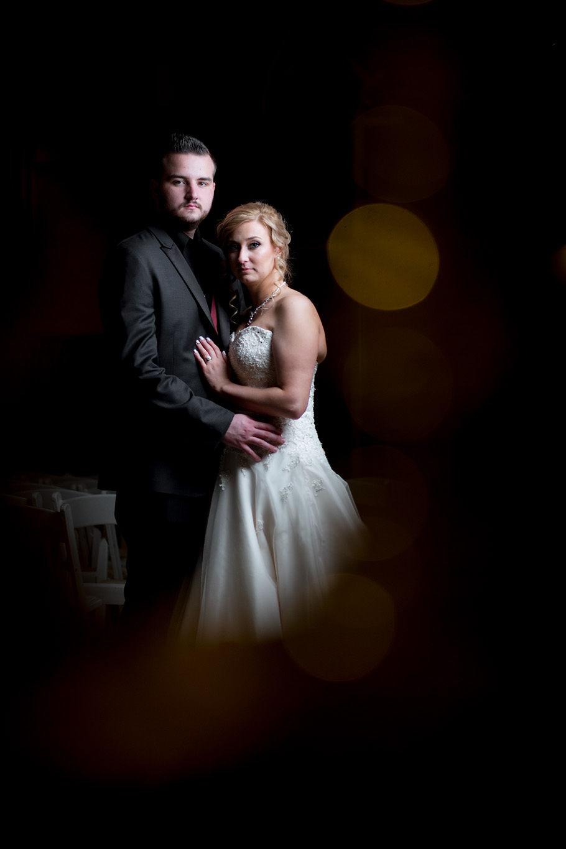 Elegant, stunning and artistic wedding portrait of bride and groom.
