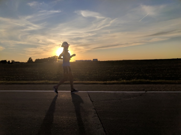 Day 38, Iowa. Cruising alone through the sunset after a pleasant day running with the Camachi Cross Country team. Photo: Jay Lee.