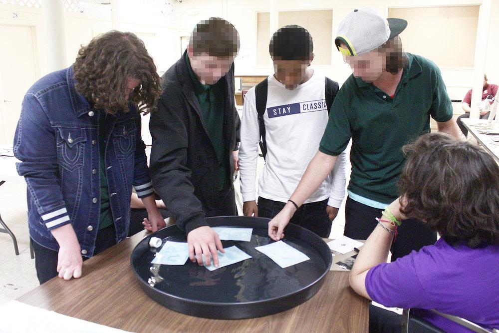 Boys developing personalized cyanotypes.jpg