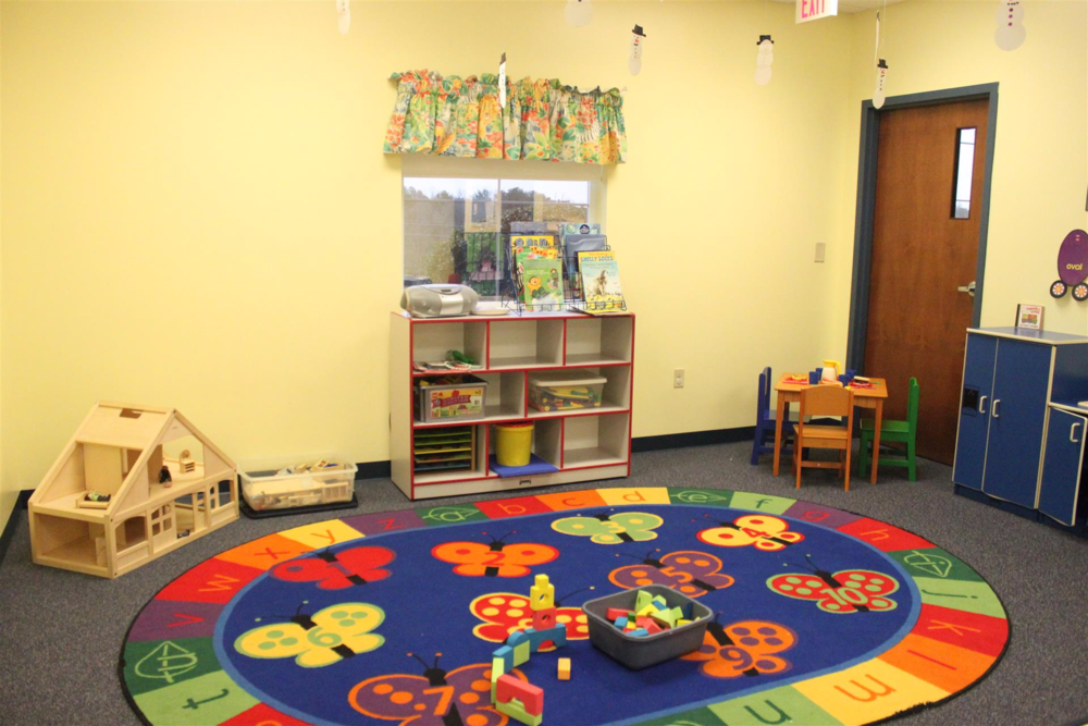 A bright carpet in each room provides a great space for carpet time each morning.