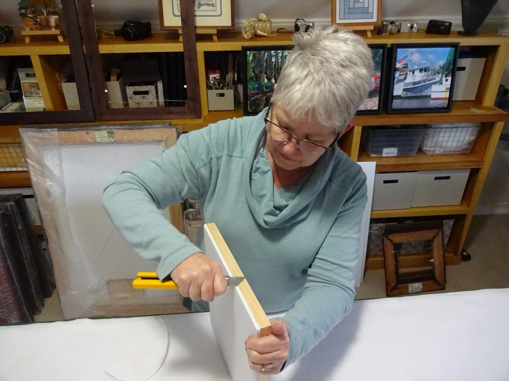 Basic Steps: - After building stretcher frames and gluing foamboard, the foamboard is trimmed. A sharp blade is required.