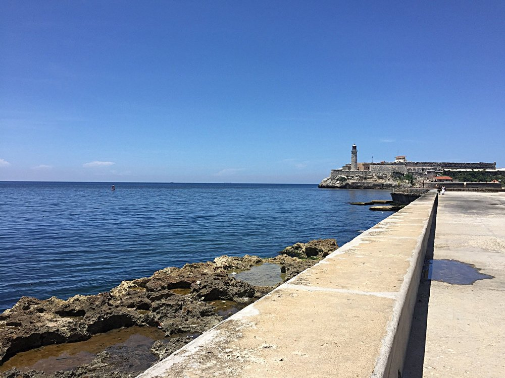 Driving along El Malecon with Castle Morro in the background