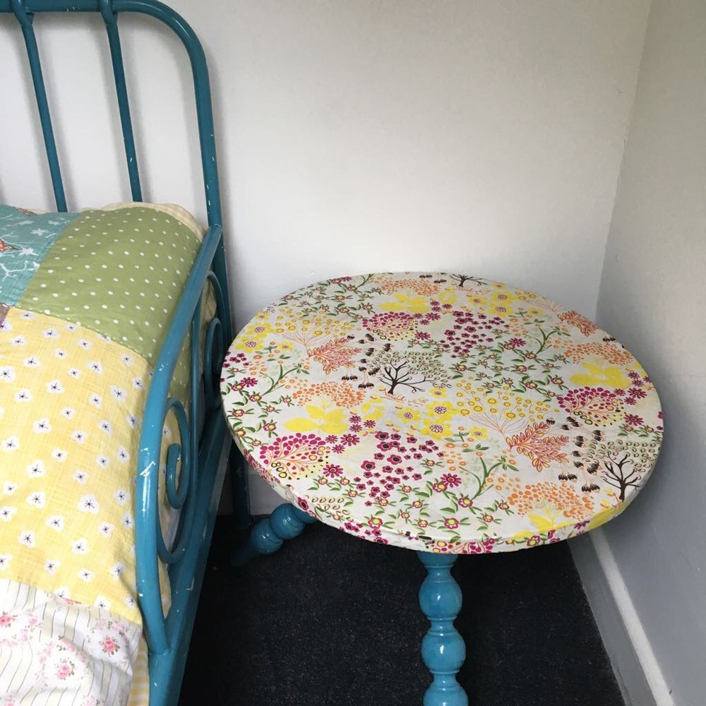 You probably get the gist now but papered side table...