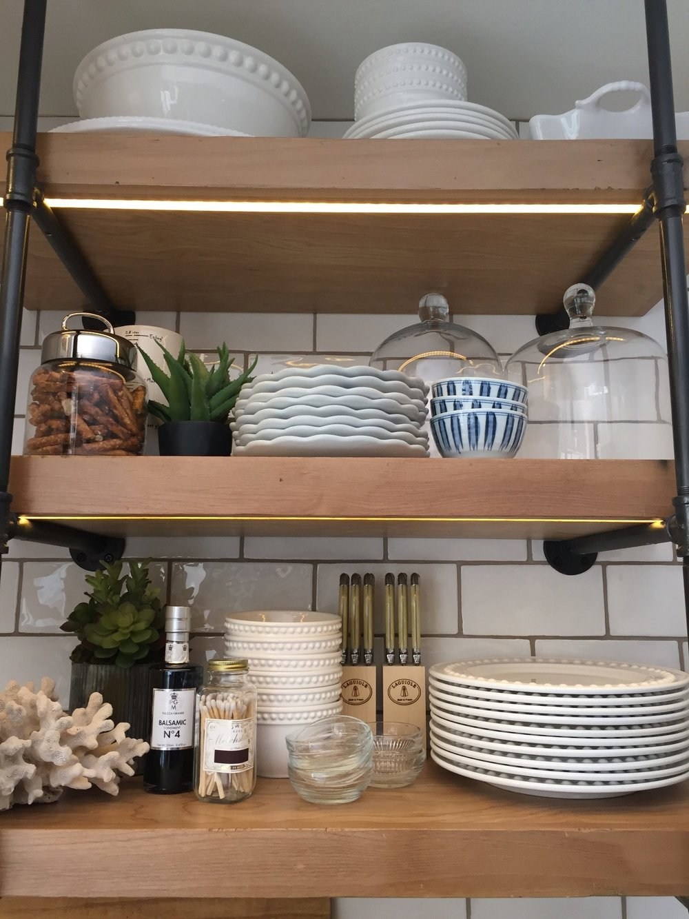Restaurant style shelves flanking the stove