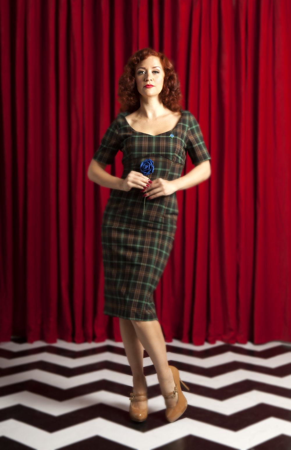 Twin Peaks Chic - Dancing girls in flannel: plaid,Eye-patched redhead has gone mad. Gary Cooper, Cary Grant,Men in uniform make us pant. Saddle shoes, jazzy blues,Coconuts house hidden clues. Perfume counter, department store,Purity, unicorns & more. Audrey's got eyebrows on fleek,This is why we're Twin Peaks Chic. Francine in Pinup Girl Clothing'sPinup Couture Priscilla DressFrancine is a photographer, performer & the producer of The Pink Room Burlesque. Known as