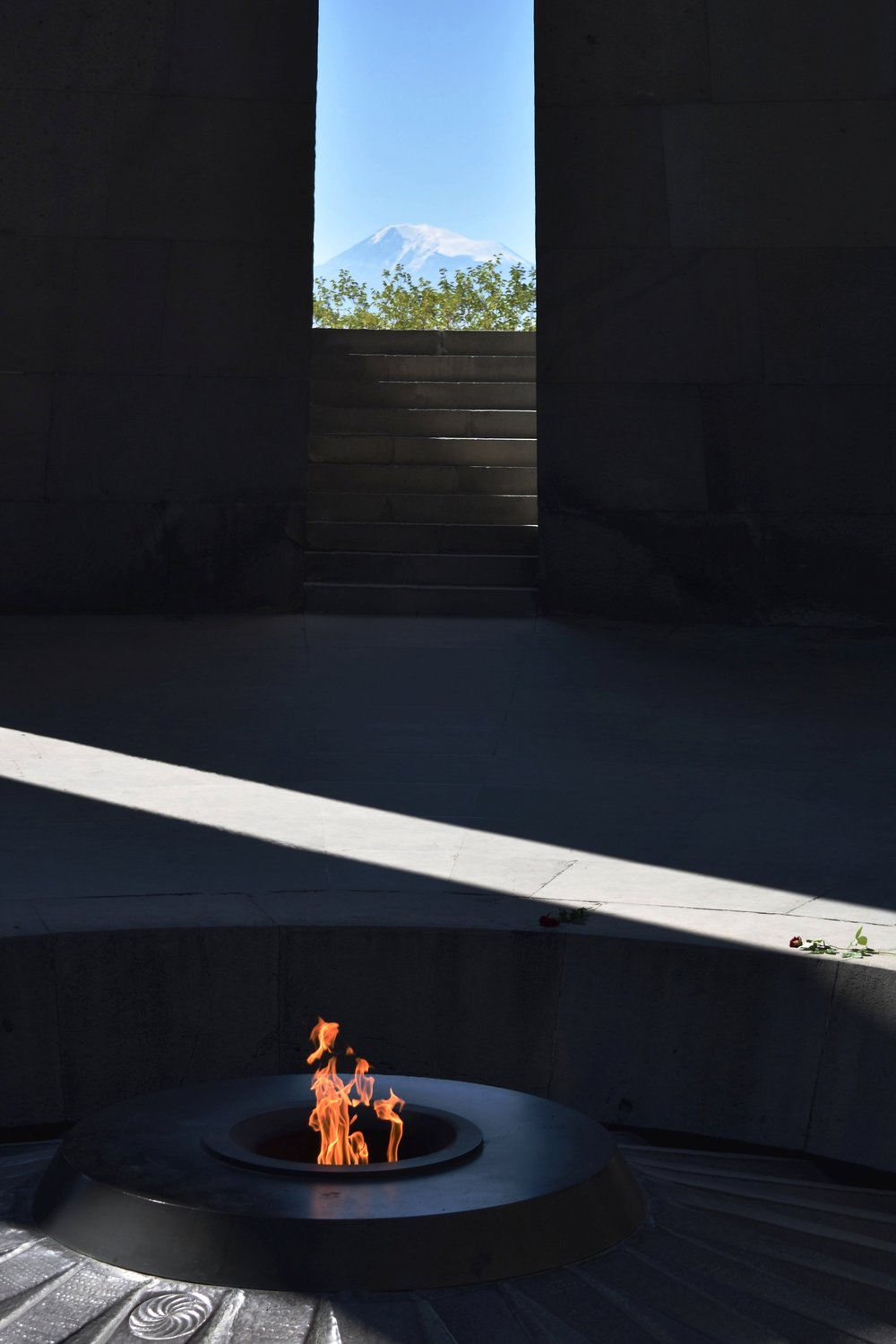 Standing inside the Memorial, with the eternal flame, and looking out at Mt. Ararat.