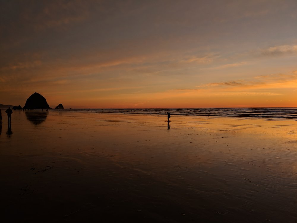 I celebrated my 1 year anniversary by doing zero work and only things which brought me joy... such as a solo road trip along the Oregon Coast. Here's a picture I took during the most amazing sunset at Cannon Beach.