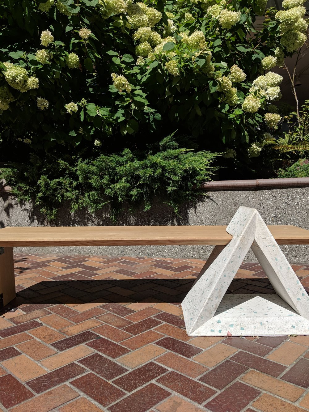 Those blue bits glinting in the white triangle capture solar energy. At night the bench becomes luminescent.