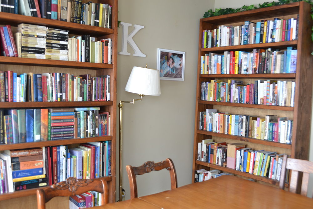 Bookshelves can be arranged by size, color, subject, author, or title.