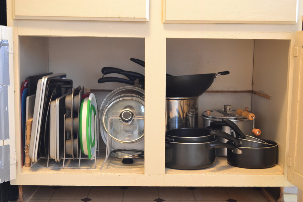 Kitchen cabinet organization. What to do with pots, pans, lids, and baking sheets.